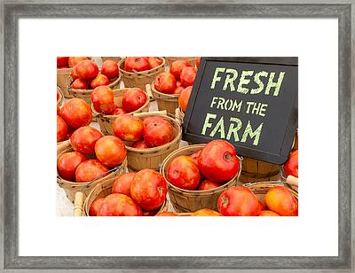 Fresh Tomatoes In Baskets At Farmers Market Framed Print by Teri Virbickis