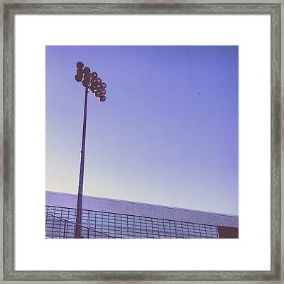 Friday Night Light Framed Print