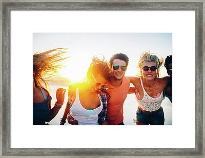 Friends Dancing On Beach In Sunset Framed Print by Wundervisuals