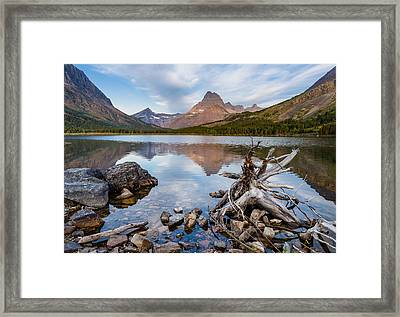 From The Shoreline Of Swiftcurrent Lake Framed Print by Greg Nyquist