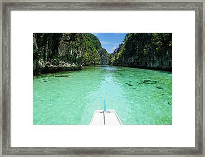 Front Of An Outrigger Boat In The Clear Framed Print by Michael Runkel
