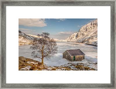 Frozen Lake Ogwen Framed Print by Adrian Evans