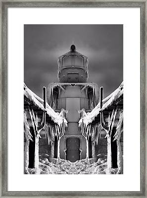Frozen Lighthouse And Pier Surreal Framed Print by Dan Sproul