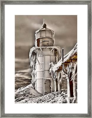 Frozen Lighthouse Framed Print by Dan Sproul