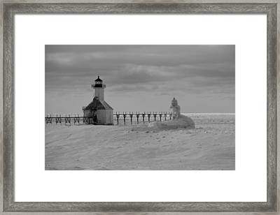 Frozen Lighthouses In Michigan Framed Print by Dan Sproul