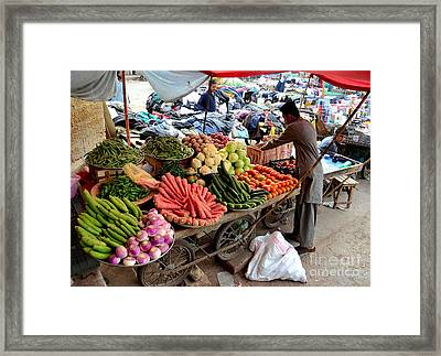 Fruit And Vegetable Seller Tends To His Cart Outside Empress Market Karachi Pakistan Framed Print by Imran Ahmed