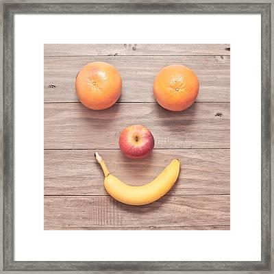 Fruit Face Framed Print by Tom Gowanlock