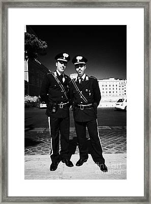 full length of Two Arma Dei Carabinieri Italian police officers on duty in Piazza Venezia Rome Lazio Framed Print