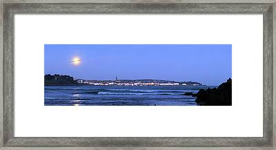 Full Moon Over Coastal Town Framed Print by Laurent Laveder