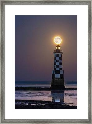 Full Moon Over Lighthouse Framed Print by Laurent Laveder