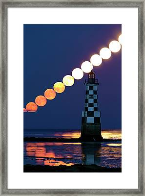 Full Moon Rising Over Lighthouse Framed Print