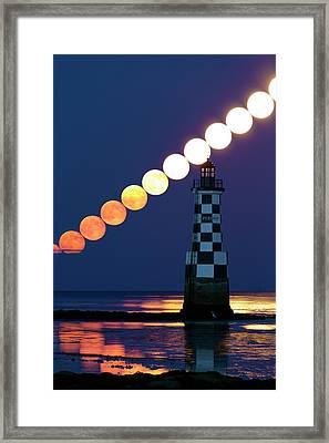 Full Moon Rising Over Lighthouse Framed Print by Laurent Laveder