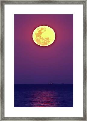 Full Moon Rising Over The Sea Framed Print by Luis Argerich