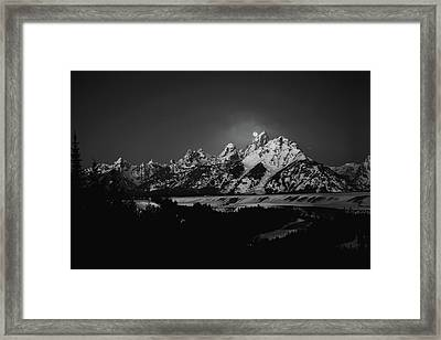 Full Moon Sets In The Teton Mountain Range Framed Print