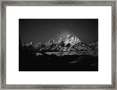 Full Moon Sets In The Teton Mountain Range Framed Print