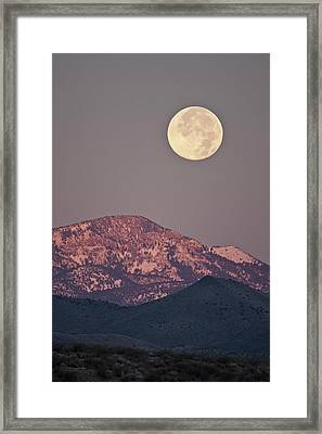 Full Moon Setting Over Snow-covered Framed Print by Larry Ditto