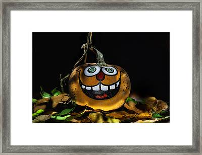Funny Whimsical Halloween Pumpkin In A Bed Of Fall Leaves Framed Print