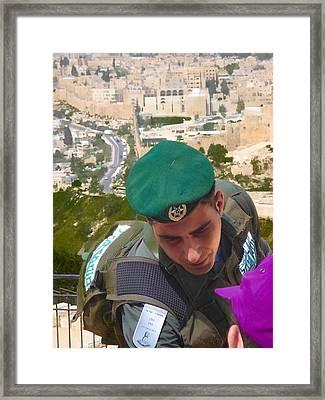 Gallant And Kind Israeli Soldier Framed Print by Sandra Pena de Ortiz
