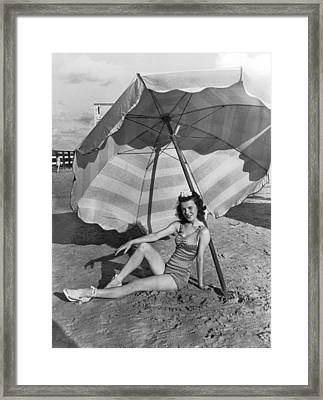 Galveston Beach Girl Framed Print by Underwood Archives