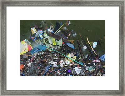 Garbage Floating In Seawater Framed Print by Robert Brook