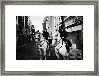 Garda Siochana Mounted Police On Horseback Taking Notes In Temple Bar Dublin Republic Of Ireland Framed Print by Joe Fox