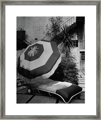Garden Chaise Lounge Framed Print by Peter Nyholm