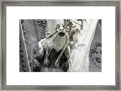 Gargoyle Perched On Notre Dame Framed Print