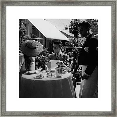 Gaston De Clairville At Lunch With A Woman Framed Print by Roger Schall