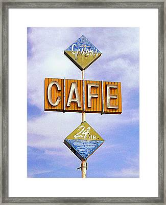 Gaston's Cafe Framed Print by Ron Regalado