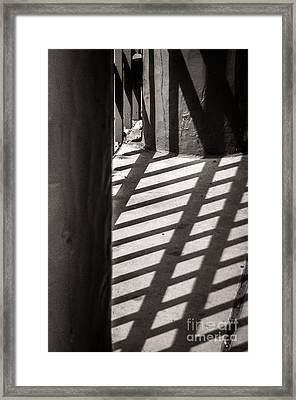 Gate Shadows II Framed Print