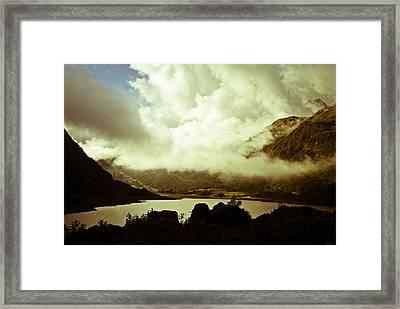 Gathering Clouds  Framed Print