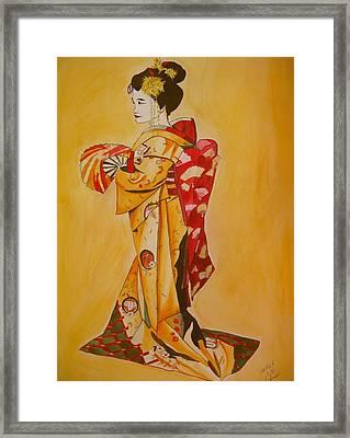 Geisha In Gold Kimono Framed Print by Sacha Grossel