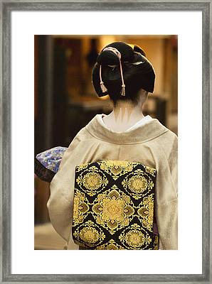 Geisha Showing Her Nape Make-up And Obi Framed Print by Philippe Widling