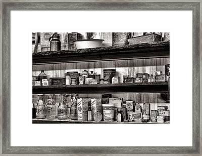 General Store Shelves Framed Print by Olivier Le Queinec