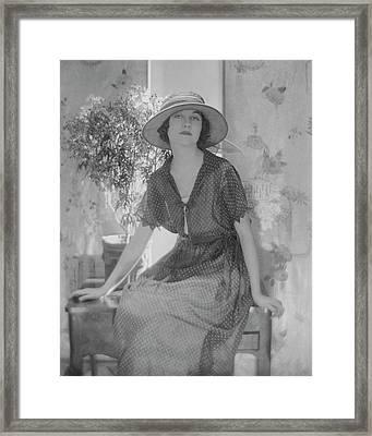 Genevieve Tobin In A Swiss Style Dress Framed Print by Adolphe De Meyer