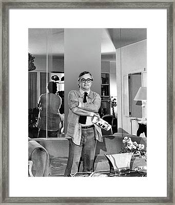 Geoffrey Beene With His Arms Crossed Framed Print