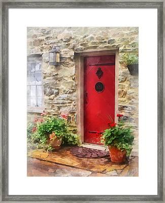 Geraniums By Red Door Framed Print by Susan Savad