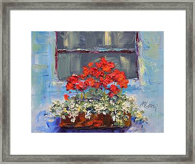 Geraniums Sunbathing Framed Print by Marie Green