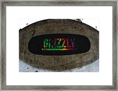 Get A Grip Framed Print by Mick Logan