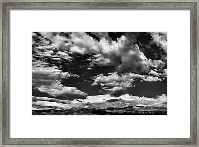 Getting Lost In A Mountain Sky Framed Print by Leland D Howard