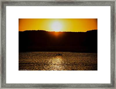 Framed Print featuring the photograph Getting The Catch Home by Kathy Ponce