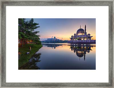 Getting The Perfect Shot Framed Print by Mario Legaspi