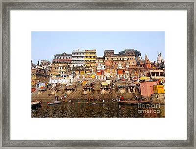 Ghats In The River Ganges At Varanasi In India Framed Print by Robert Preston