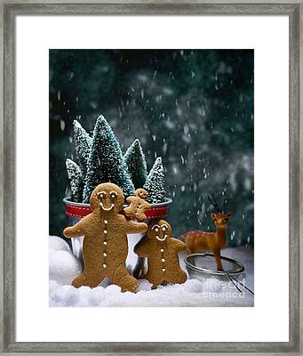 Gingerbread Family In Snow Framed Print