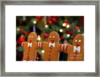 Gingerbread Men In A Line Framed Print by Amy Cicconi