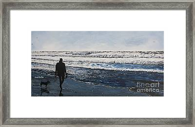 Girl And Dog Walking On The Beach Framed Print