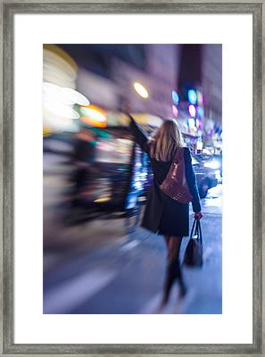 Girl Catching A Taxi In Manhattan Framed Print