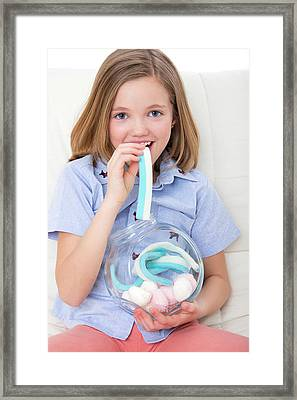 Girl Eating Candy Framed Print by Lea Paterson