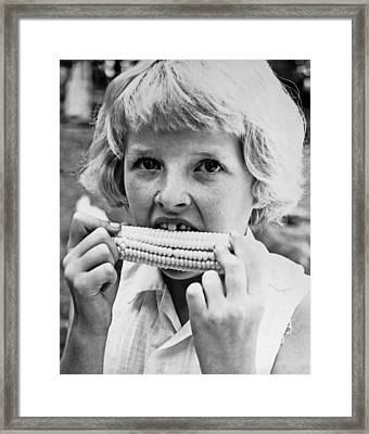 Girl Eating Corn On The Cob Framed Print by Underwood Archives