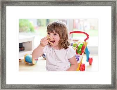 Girl Eating French Fries Framed Print by Aberration Films Ltd